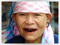 Laotian woman chewing betel nut