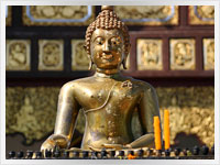 statue of the teaching buddha at a thai temple