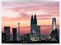 Nighttime photo of Petronas towers in Kuala lumpar, Malaysia