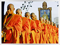Thai Buddhist monks going to collect alms