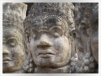 head of a granite statue at Angkor Wat temple in Cambodia