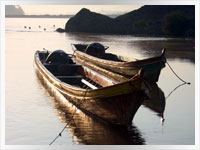 traditional fishing boats on the mekong river in Laos