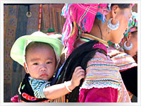 Lisu hill tribe woman carrying baby on her back in vietnam