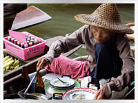 woman selling food on the floating market in Kuala Lumpar, Malaysia